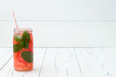 Detox fruit infused flavored water. Refreshing summer homemade cocktail. Clean eating. Copy space background Royalty Free Stock Photo