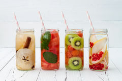 Detox fruit infused flavored water. Refreshing summer homemade cocktail. Clean eating. Copy space background Royalty Free Stock Images