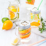 Detox fruit infused flavored water. Refreshing summer homemade lemonade cocktail Stock Images