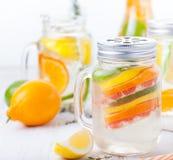 Detox fruit infused flavored water. Refreshing summer homemade lemonade cocktail Stock Photos