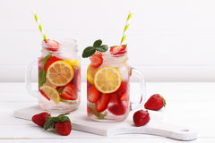 Detox fruit infused water. Detox fruit infused flavored water. Refreshing summer homemade cocktail stock images