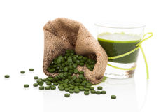 Detox. Green pills with green juice. Royalty Free Stock Photography