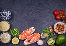 Detox healthy food concept with salmon fish, vegetables, fruits and ingredients for cooking. Selection of healthy and good for heart food. View from above, top Stock Images