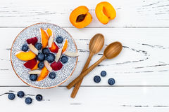 Detox and healthy superfoods breakfast bowl concept. Vegan coconut milk chia seeds pudding over rustic table with various fruits. And blueberries. Overhead, top Stock Image