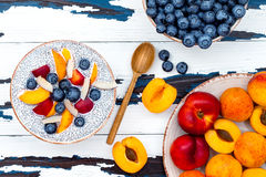 Detox and healthy superfoods breakfast bowl concept. Vegan coconut milk chia seeds pudding over rustic table with various fruits Royalty Free Stock Photography