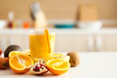 Detox juice next to fruits and vegetables. At the kitchen stock images