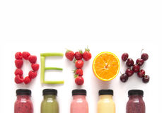 Detox juice smoothies background. Detox word made with fruits from assorted fruit smoothies over a white background stock photo