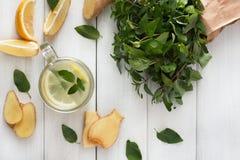 Detox lemonade smoothie ingredients on white wood background, top view Royalty Free Stock Photo