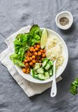 Detox moroccan spiced chickpea glow bowl on a grey background, top view royalty free stock photo