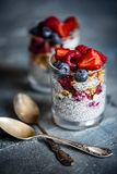 Detox vegan super-foods breakfast with berries in glass on dark background royalty free stock photography