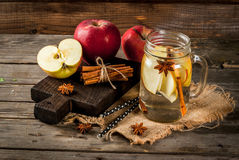Detox water with apple, pear and cinnamon Stock Photos