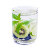 Detox water with Blueberries, kiwi and basil leaves. Royalty Free Stock Photo