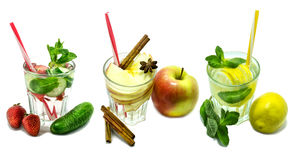 Detox water cocktail Lemon, mint, apple, strawberry, cucumber, cinnamon isolated on white background. Stock Photos