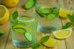 Detox water, fresh organic lemonade with ice, cucumber, lemon an Stock Photography