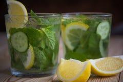 Detox water, fresh organic lemonade with ice, cucumber, lemon an Royalty Free Stock Images