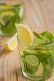 Detox water, fresh organic lemonade with ice, cucumber, lemon an Stock Photo