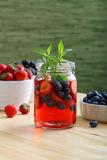 Detox water or fruit juice with berries Royalty Free Stock Images