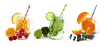 Detox water with fruit in mason jars isolated on white Royalty Free Stock Images