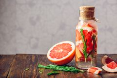 Detox water with grapefruit and rosemary. Royalty Free Stock Photos