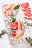 Detox water with grapefruit and rosemary Stock Photo