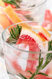 Detox water with grapefruit and rosemary Royalty Free Stock Photo