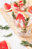 Detox water with grapefruit and rosemary Royalty Free Stock Images