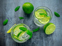 Detox water with green lime mint in glass cup Royalty Free Stock Images