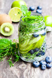Detox  water. Homemade summer fruit drink with lime and kiwi and Stock Images