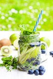 Detox  water. Homemade summer fruit drink with lime and kiwi and Royalty Free Stock Photos