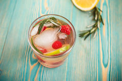 Detox water with ice and fruits in glass, toned Royalty Free Stock Photo