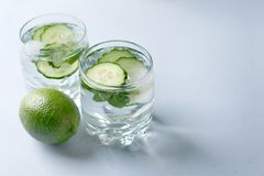 Detox water infused with sliced cucumber and springs of mint, copy space.  Royalty Free Stock Photos