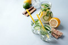 Detox water infused with sliced cucumber and springs of mint, copy space.  Stock Images
