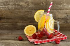 Detox water in a jar against rustic wood Royalty Free Stock Photography