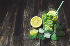 Detox water with lemon, cucumber and mint. On rustic wooden background Royalty Free Stock Photos