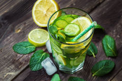Detox water with lemon, cucumber and mint. On rustic wooden background. Top view. Selective focus Stock Photography