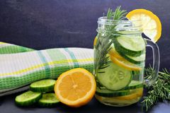 Detox water with lemon, cucumber and rosemary, in mason jar Royalty Free Stock Images