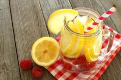 Detox water with lemon and raspberries in mason jar glass Royalty Free Stock Images