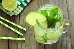 Detox water with lime and cucumbers above view in jar Royalty Free Stock Image