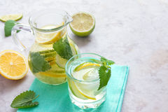 Detox water with lime, lemon and mint Stock Images