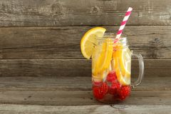 Detox water in a mason jar against wood Stock Photos