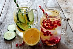 Detox water in mason jar glasses against rustic wood Royalty Free Stock Photos