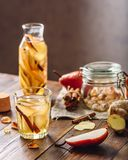 Detox Water with Pear, Cinnamon, Ginger. Detox Water Infused with Sliced Pear, Cinnamon Stick, Ginger Root and Some Sugar. Ingredients on Wooden Table. Vertical Royalty Free Stock Photos