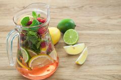 Detox water with raspberries, lime, mint for weight loss closeup. Detox water with raspberries, lime, mint for weight loss in jug. Diet, detoxication, weighеt Royalty Free Stock Image