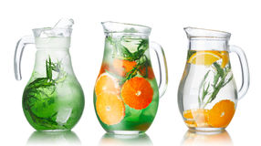 Detox water with tarragon. Collection of glass pitchers with tarragon infused detox water stock photo