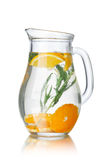 Detox water with tarragon. Glass pitchers with tarragon (tarkhun) infused detox water royalty free stock images