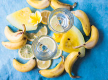 Detox Water with Yellow Fruits on blue background Stock Photo
