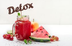Detox watermelon smoothies and ingredients. The word detox from chia seeds royalty free stock photo