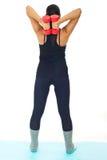 Detrás de la mujer que hace ejercicios con la alarma muda Imagen de archivo