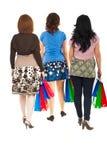 Detrás de mujeres que recorren en las compras Imágenes de archivo libres de regalías