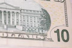 Detrás de un billete de dólar diez Imagen de archivo libre de regalías